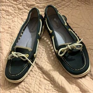 Navy blue Sperry Topsider boat shoes.
